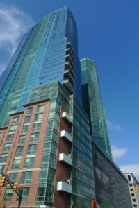 view of glass windows in 77 Hudson condo building