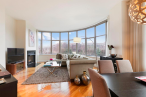 The interior of a Hudson County home, featuring wooden floors and a beautiful bay window.